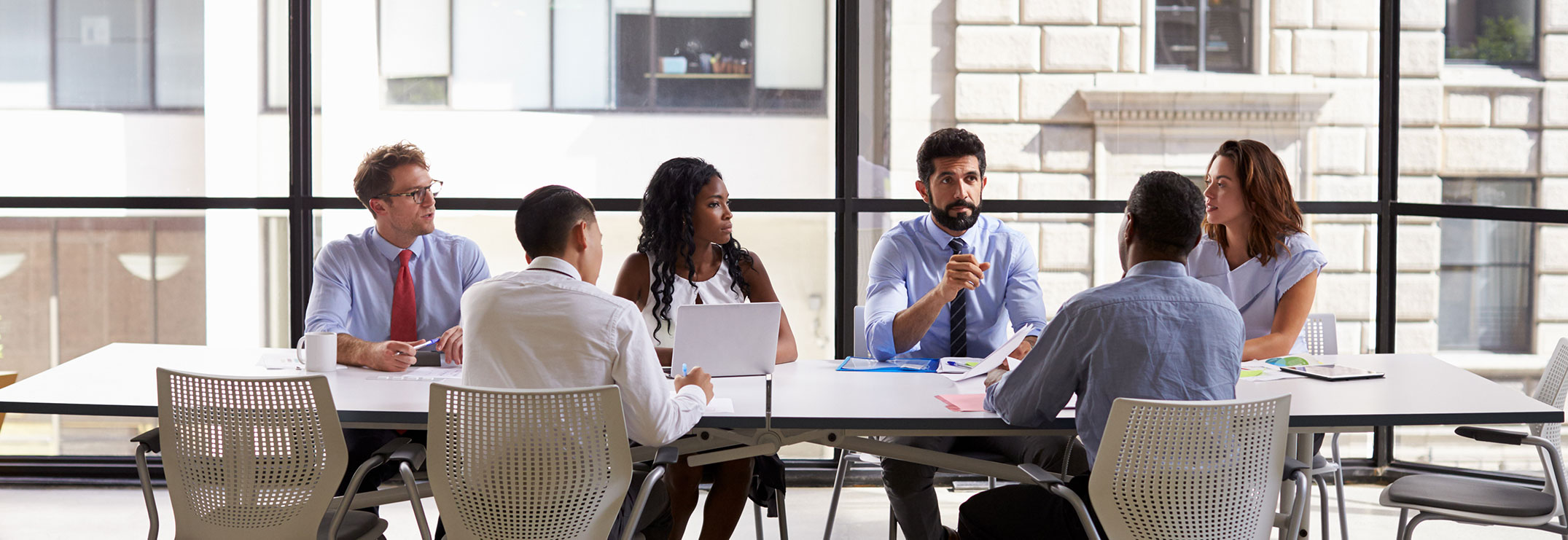 Team brainstorm in meeting room
