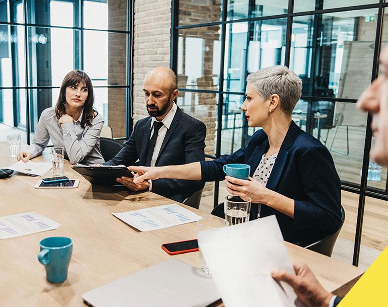 Meeting in office board room